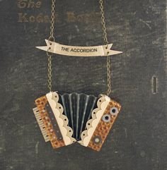 The Accordion Necklace / Mustard Seed and Grey. via Etsy.
