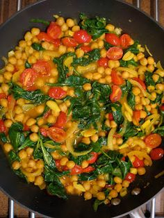 Spicy Chick Pea, Spinach,  Tomato Dish - super warming dish! Take out the oil and replace with water. :D Nutritarian.