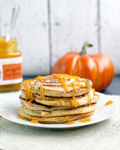 Pumpkin Swirl Pancakes with Pumpkin Butter Topping from www.thisgalcooks.com #pumpkin #pancakes #breakfast