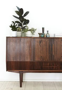 plants on mid century sideboard