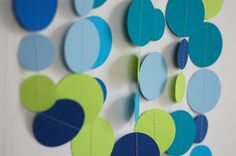 Paper Garland, wedding decor, baby shower decorations, party decorations, nursery decor, teal, baby blue, navy, bright blue, citrus green. $10.00, via Etsy.