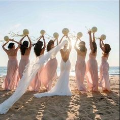 What a cool photo to take with your bridesmaids! Pin it and add to your shot list! ❤️ | www.mysweetengagement.com