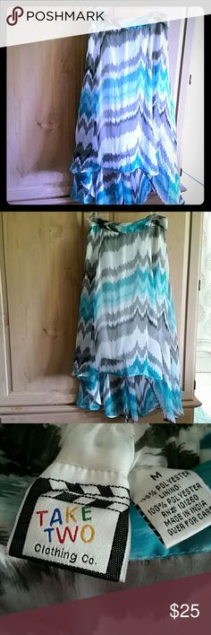 Hi low chiffon skirt Beautiful turquoise, black, grey, and white lined hi low skirt, Chiffon polyester with lining. New Never worn  Flowing. Finished hem. The  lining provides cover for the sheer quality.  Very nice pattern. TAKE TWO Skirts High Low