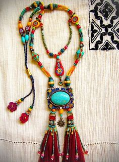 i like the shape - make with large bead on peyote background and tassels ~ The Bohemian Soul Jewelry ~ Jewelry Crafts, Jewelry Art, Beaded Jewelry, Handmade Jewelry, Beaded Necklace, Jewelry Design, Fashion Jewelry, Necklaces, Jewellery