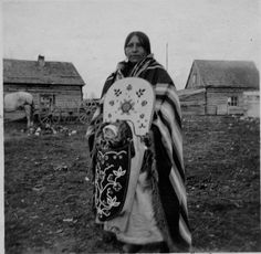 Woman (Salish) with infant in cradle board, Flathead Indian Reservation, St. Ignatius, Montana, 1917  Image courtesy Marquette University Archives, 10861