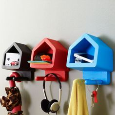 We all want to be a little more organized—get the whole family involved with this bright idea for your entryway! Each wooden unit features a storage cubby and two sturdy pegs perfect for a quick pick-u...  Find the Happy House Shelves, as seen in the Organized Office Collection at http://dotandbo.com/collections/labor-day-sale-organized-office?utm_source=pinterest&utm_medium=organic&db_sku=DIM0083-org