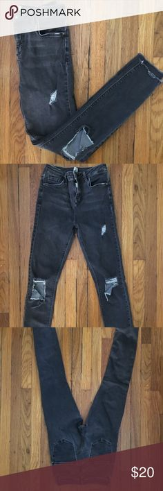 TopShop Jaime Destroyed jeans Destroyed dark grey wash stretchy denim jeans. Normal wear. Minor pull. Runs really small more like a US 24/25 Topshop Jeans Skinny