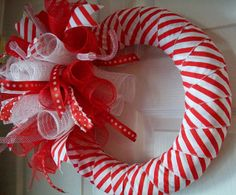 THIS CANDY CANE INSPIRED WREATH IS SO ADORABLE!!! Measures approx.18 in diameter.    ***Made in a smoke-free/pet-free home***    ***Shipping:3-5 Business days from order date*** USPS with tracking number. I do ship and wire in all my wreaths. The boxes are perfect for storing your wreath in when you are not displaying it.    ~~~PLEASE CHECK OUT THE OTHER ITEMS FOR SALE IN MY SHOPS~~~  click on link: https://etsy.com/shop/ADoorableCreations05  SHOP # 2 click on link: h...