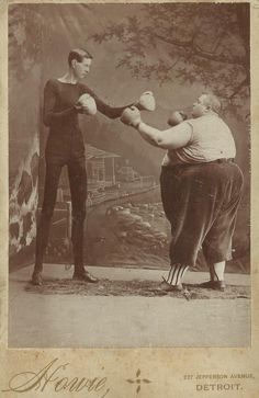 """the-absolute-funniest-posts:  ennish: muchneededmerch: just-collecting-dust: Boxers: George Moore: age 21, weight 110, height 7'2""""  Fred Howe: age 21, weight 435, height 5'4""""  Courtesy of the Victorian Images Group on Facebook They're like Tim Burton characters. ^^^^^^^ Follow this blog, you'll love it on your dashboard!"""