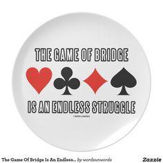 "The Game Of Bridge Is An Endless Struggle #thegameofbridge #duplicatebridge #endless #struggle #fourcardsuits #bridgeplayer #bridgeteacher #bridgesaying #bridgepartner #wordsandunwords Here's a plate featuring the four card suits along with the saying ""The Game Of Bridge Is An Endless Struggle""."