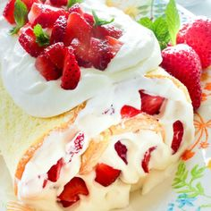 This Easy Strawberry Cake Roll looks fancy but it's so simple to make!  It's a lovely spring or summer dessert for any occasion!