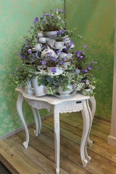 Teapots and cups – what a great way to display flowers!