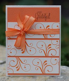 Beautiful monochrome card! Three strips of white with flourishes stamped in ink that matches card base; ribbon; sentiment.