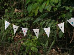 Book Paper Bunting with cut-out and coloured hearts for weddings or events