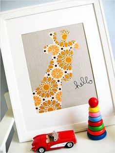 A cheery giraffe, delicate, loopy embroidery and a chic color palette make this nursery wall art that we heart. Plus, you can personalize it by choosing your own favorite animal and wording.    What You'll Need: Linen, pattern,embroidery floss and a frame.