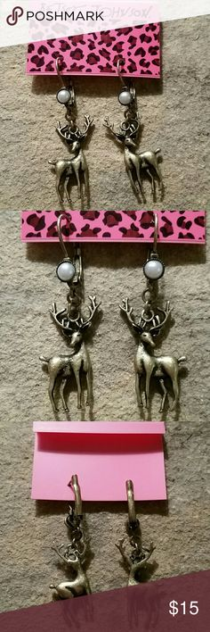 """Betsey Johnson Brass Deer w/ Pearl Dangle Earrings Betsey Johnson leverback deer earrings (deerrings ;) ) with a faux pearl on the base of the leverback. The metal appears to be brass. They are 1.25"""" long from the drop, and a little over .5"""" wide. New, never worn, still on original card.  Thank you for checking out my closet, and happy poshing!! :)   SORRY, NO TRADES AT THIS TIME. Betsey Johnson  Jewelry Earrings"""