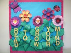 """Spring summer library bulletin board. """"Read to grow your mind"""". Flower bulletin board."""