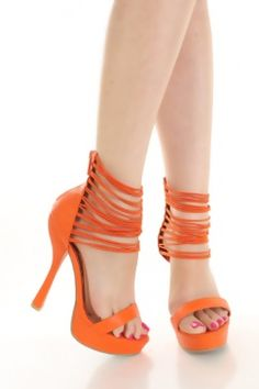 Orange Faux Leather Elastic Strappy Ankle shoes. The heel height is 5 3/4 inches with a platform height of 1 1/2 inches. You can find these shoes at Ami Clubwear for just $27.99!!!  **TAX NOT INCLUDED**