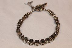 Silver Hockey Bracelet with Charm by dandibyCathy on Etsy, $20.00