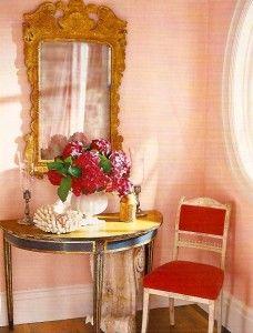 peach walls, gold, black, and pops of red? love it! Veranda Magazine