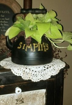 Pothos in an old tea kettle I painted.