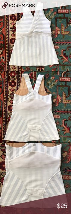 Lululemon workout tank Grey and white with mesh detail. Small pocket on lower back. Built in bra for support, great condition lululemon athletica Tops