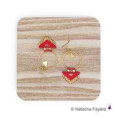 Red and gold graphic earrings hoops arrow head triangle patterns made with…