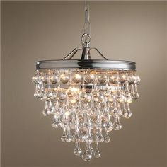 "Teardrop Wedding Cake Crystal Lantern  ""Crystal teardrops cascade from a sleek metal rim in Polished Nickel or Aged  Brass.This lantern is the perfect size for lower ceilings or a powder room. Even add some elegance to your kitchen by hanging in multiples over your kitchen island.""  3x60 watts. (candle base socket)  (16""Hx12""W)  6' chain  12' wire  6"" canopy  479.00"