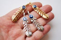 Evil Eye Pendant Charms- 2 Pcs Silver and Golden Plated Leaf Shape Turkish Evil Eye Charms With Glass Eye For Necklace Jewelry Making by PrettyTurkishThings on Etsy https://www.etsy.com/listing/270120733/evil-eye-pendant-charms-2-pcs-silver-and