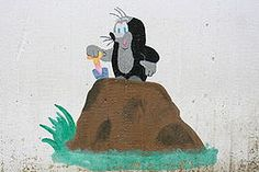 """#The_Mole (in the Czech original called #Krtek, or, for little mole, #Krteček ; Slovak Krtko) is an animated character in a series of cartoons, created by Czech animator #Zdeněk_Miler in 1956. Since its inception, the cartoon won itself an enormous popularity in many Central European countries, as well as India, China, Kazakhstan, Russia, Iraq and Japan, due its distinct lack of dialogue."""" #Maulwurf #Talpo"""