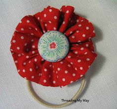 sewing fabric flowers onto pony tail holder, SECURELY