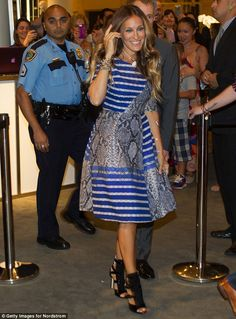 Sarah Jessica Parker takes on the fashion challenge of mixing snakeskin with stripes.