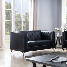 Upgrade your space with this elegant sofa set featuring pleated back design and angled metal legs. The pocket coil cushions provide firm seating and the microfiber backed faux leather is soft yet sturdy and easy to clean.