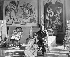 """Picasso poses in his studio at his villa, """"La California"""" on the French Riviera in 1955"""
