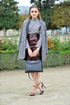 Burgundy patent leather skirt spotted at Paris Fashion Week.