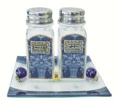 Lily Art Glass Salt and Pepper Shaker Set - Blue by Lily Art Collection. $44.95. This elegant glass salt and pepper shaker set is artistically designed featuring an exquisite blue design. The set will enhance & add that special touch to your table, and can be presented as a magnificent gift for just about any jewish special occasion. The matching tray can also be used as a nice dish when the shakers are not in use. Look out for our full line of imported Judaica f...