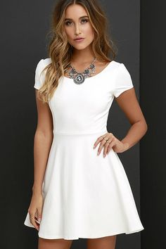 Blue ribbons and trophies may as well come in the mail along with the Winning Look Ivory Skater Dress! A rounded neckline and scooping back lay between gathered short sleeves amid a knit, princess-seamed bodice. Fitted waist transitions into a classic skater skirt. Hidden back zipper.