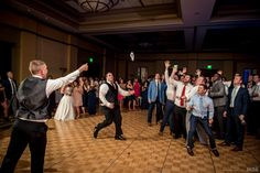 Groom tosses the garter to waiting crowd #Michiganwedding #Chicagowedding #MikeStaffProductions #wedding #reception #weddingphotography #weddingdj #weddingvideography #wedding #photos #wedding #pictures #ideas #planning #DJ #photography