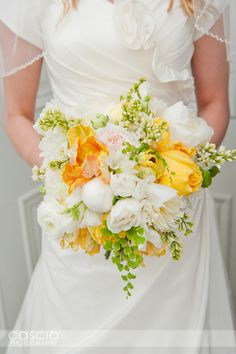 different greenery, softer yellow shade, touch of light blue, a bit of gray and chalk pink-- garden roses, hydrangea and more. bind in ivory satin with white lace overlay