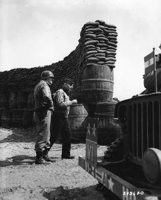 Major General Lucian Truscott and Lieutenant General Ira Eaker at Anzio, Italy, 6 Apr 1944