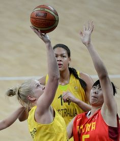 Australia's Abby Bishop rebounds against China's Xiaoyun Song.