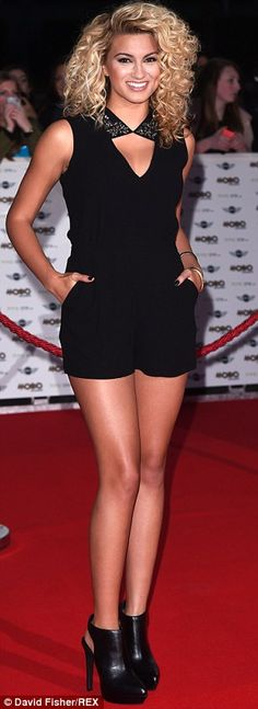 Tori Kelly showed off her sensational legs in a cute black jumpsuit and killer shoe boots...