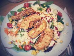 Izabela's grilled chicken salad with green leaves, tomatoe, cucumber, sweet peppers, sweetcorn in a creamy yoghurt sauce with garlic, parmesan and herbs