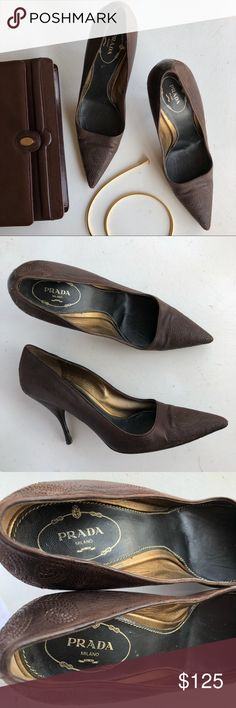 Prada embroidered brown leather pumps Authentic Prada brown nappa leather pumps. Embroidered design on leather, pointy toes. Some wear on base of heels, not noticeable when wearing. Size 39 Prada Shoes Heels