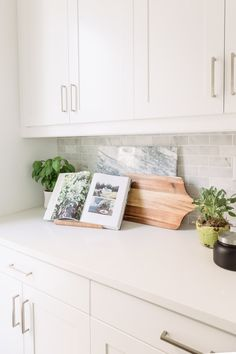 PURE SALT INTERIORS // ESENCIA PROJECT // KITCHEN // Cutting boards, herbs, marble backsplash, candle....