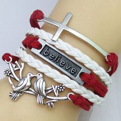Rotita White and Red Braided Cross Bracelet featuring polyvore fashion jewelry bracelets white bracelet bangle faux leather bracelet white bangle cross jewelry woven bracelet