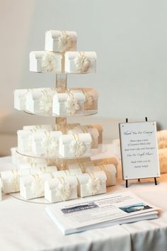 Boxed rum cake wedding favors arranged in a beautiful tower {Photo by Jonathan Young Weddings via Project Wedding} Wedding Cake Boxes, Wedding Favours, Wedding Cakes, Wedding Invitations, Wedding Reception, Perfect Wedding, Dream Wedding, Young Wedding, Rum Cake