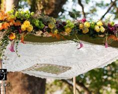 Mondo floral design and love bird wedding canopy