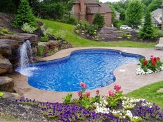 Love the color, stone accents and stamped concrete surrounding this pool. | http://homechanneltv.blogspot.com/2014/05/cool-pools.html#more #coolpools