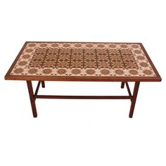 Display a lush flower arrangement or your collection of photography books on this vintage tile coffee table, artfully crafted in Morocco.   ...